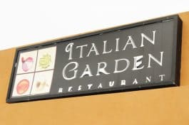 Italian Garden's sign visible from the road.