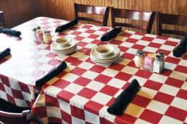 A set table waiting for you to sit down and be served.