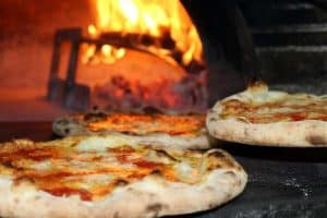 Fresh pizza baking in oven